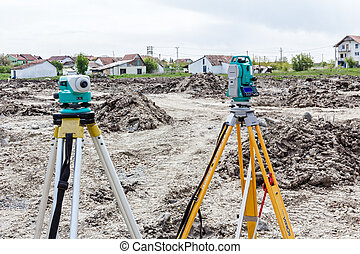 Geodesist device on a building site. Civil engineer with...