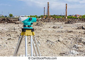 Geodesist device on a building site Civil engineer with...