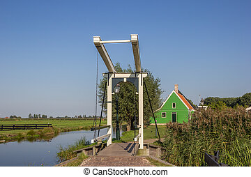 Little white bridge and small wooden house in Zaanse Schans