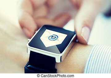 close up of hands with email icon on smartwatch - business,...