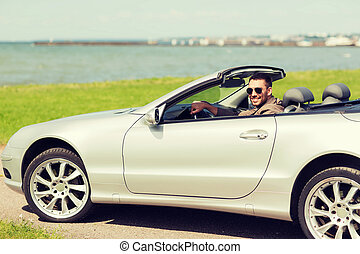 happy man driving cabriolet car outdoors - auto business,...