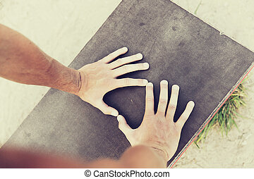 close up of man hands exercising on bench outdoors -...