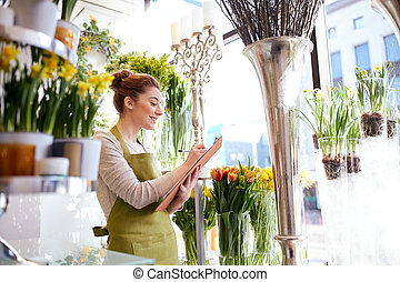 florist woman with clipboard at flower shop - people, sale,...