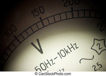 Vintage analog voltmeter dial closeup Shallow DOF