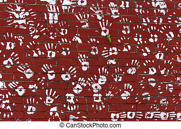 Brick Wall With Hands - The red brick wall with hand marks...