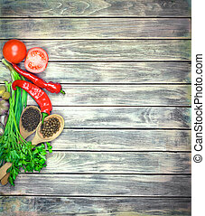 Fresh green ingredients for vegetable salad on wood...