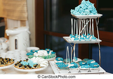 Blue baked sweets on the multi-layered dish