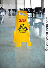 Wet Floor Caution Sign - Wet floor caution sign on floor