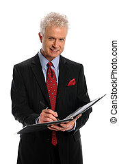 Businessman With Ledger - Mature businessman writing on...