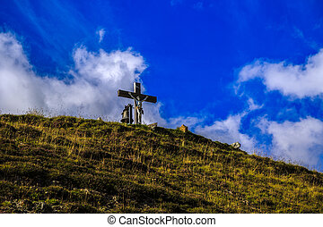 cross with Jesus on the mountain in Switzerland
