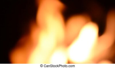 Blurred burning flames or fire in fireplace. Suitable for...