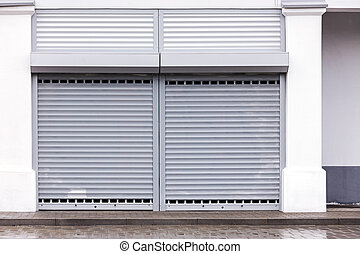 warehouse facade wall with corrugated metal gate