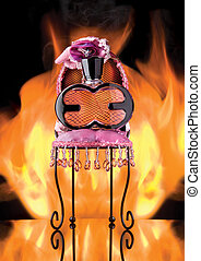 Perfume bottle on fancy chair with flames in the background