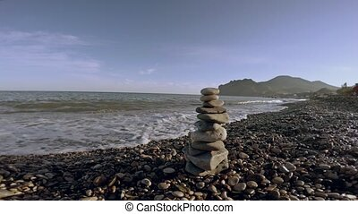 zen balance stones on the seashore