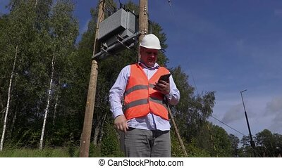 Electrician using tablet PC and take transformer technical...