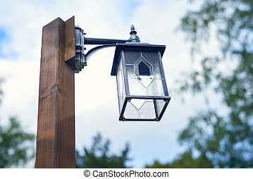 Street lamp over sky background, view from below