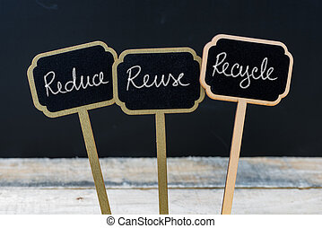 Business message Reduce, Reuse, Recycle written with chalk...