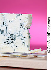 Blue cheese on cutting board. Shallow DOF