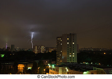 lightning in night sky in town