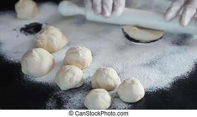Preparing Ukranian Pork Dumplings - Rolling out dough and...