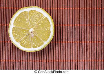 Lemon on wicker - Fresh lemon on a nice wicker carpet as...