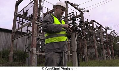 Electrician take pictures in electrical substation