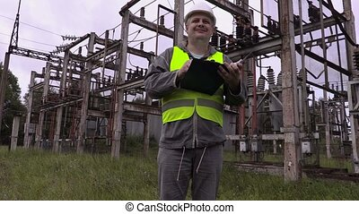 Happy electrician showing o.k sign