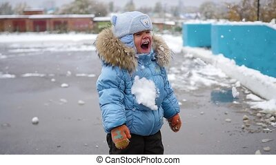 child have fun playing with snow winter