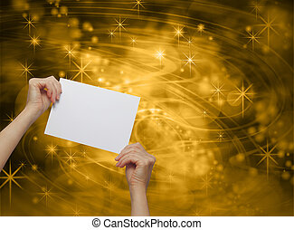 Message Card on Gold Background - Female hands holding up a...