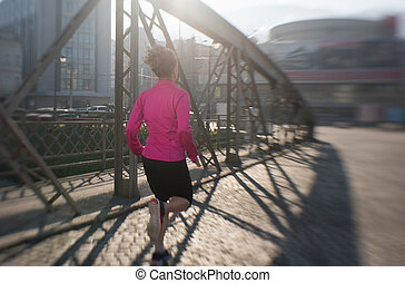 sporty woman jogging on morning - sporty woman running on...