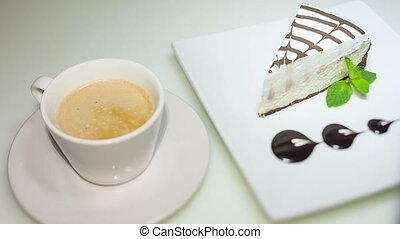 coffee and cheese cake on white background