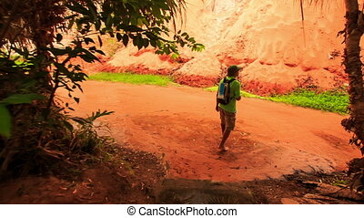 Tourist Walks to Sun Reflection on Fairy-Stream Red Waters -...