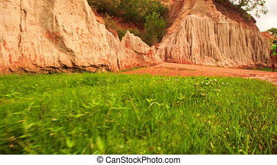 Tourist Walks along Red Waters by Fairy-Stream Rocks Photos...