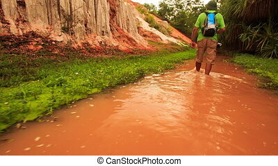 Tourist Walks along Red Waters of Fairy-Stream by Rocks...