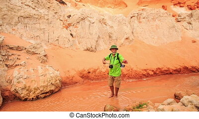 Tourist Makes Selfie against Red Hills of Fairy Stream -...