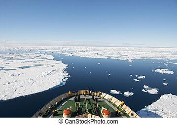 Icebreaker in the ice travel in the Arctic