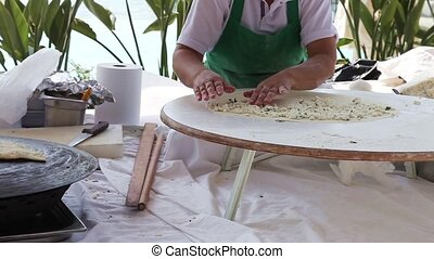 Turkish pancake gozleme - Woman making traditional Turkish...