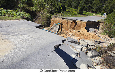 Road washed away by Hurricane Matthew - Road and pipes...