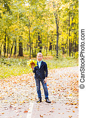 stylish boy in autumn park - stylish boy posing in autumn...