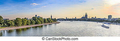 skyline of Cologne with river Rhine in late afternoon