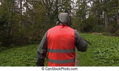 Park employee walking in park