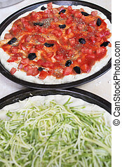 pizza tomato and black olives and pizza with zucchini -...