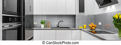White new kitchen - Panorama of new design open kitchen with...