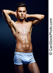 male underwear clothing - Portrait of a sexy young man in...