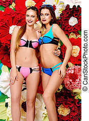 swimsuits fashion - Two pretty girls in summer swimsuits...