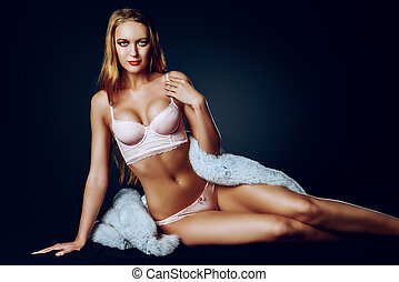 ideal figure - Sexual young woman in a beautiful pink...