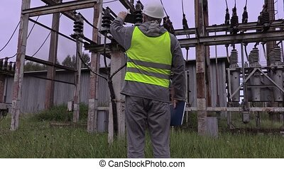 Electrician take picture of high-voltage cable