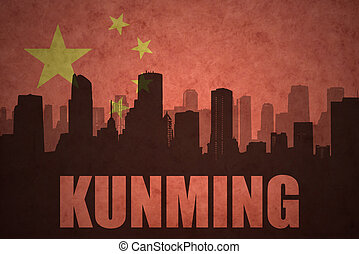 abstract silhouette of the city with text Kunming at the...