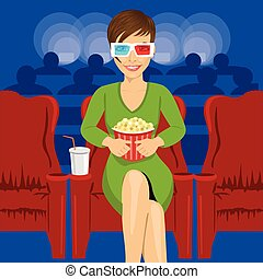 young woman sitting with popcorn in movie theater watching 3D movie smiling