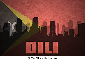 abstract silhouette of the city with text Dili at the...